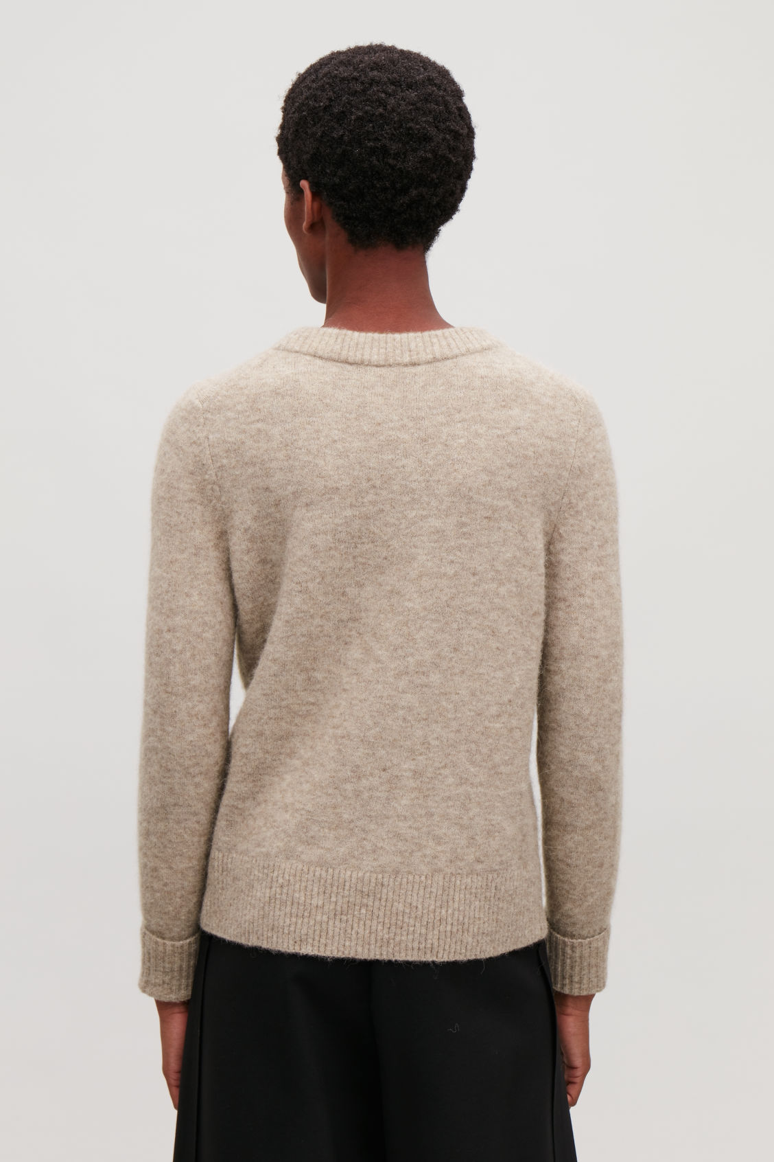 Model side image of Cos alpaca and wool jumper  in brown