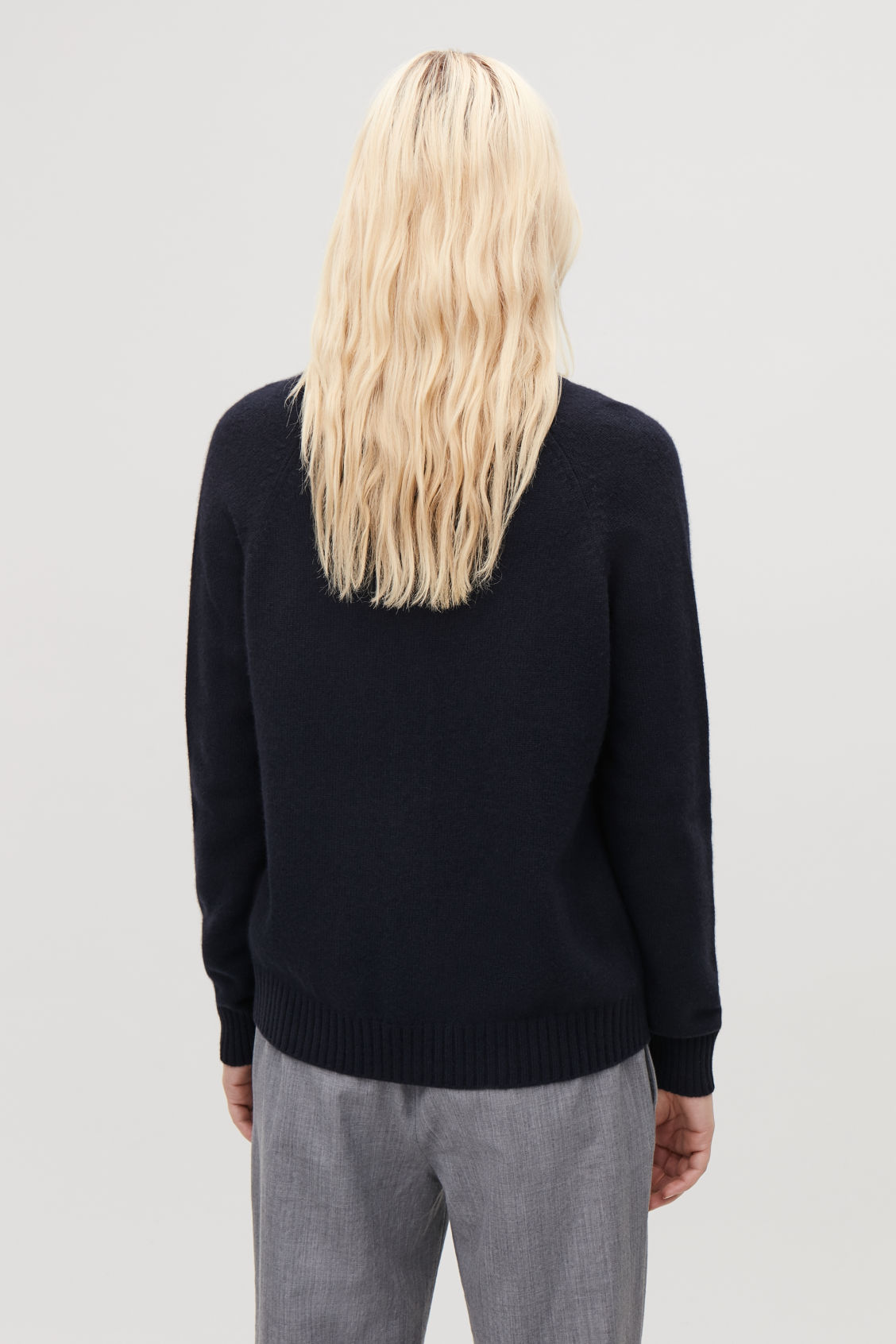 Model side image of Cos relaxed cashmere cardigan  in blue