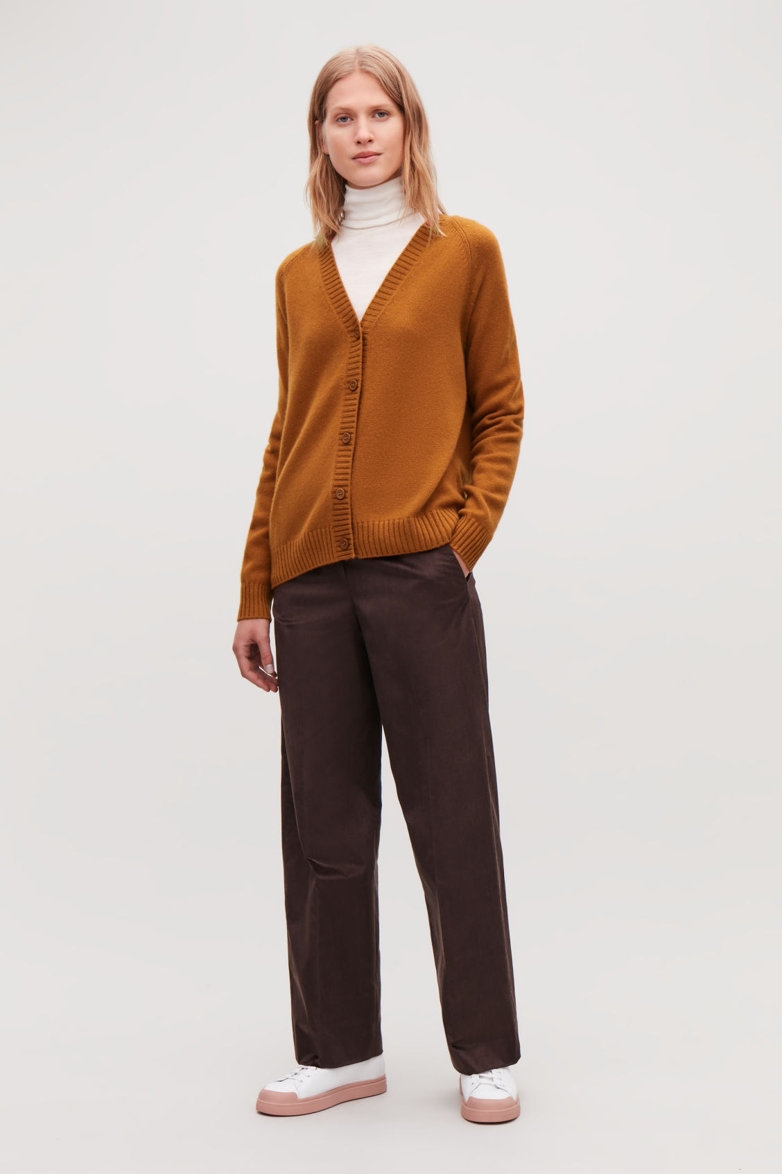 Model front image of Cos relaxed cashmere cardigan  in orange