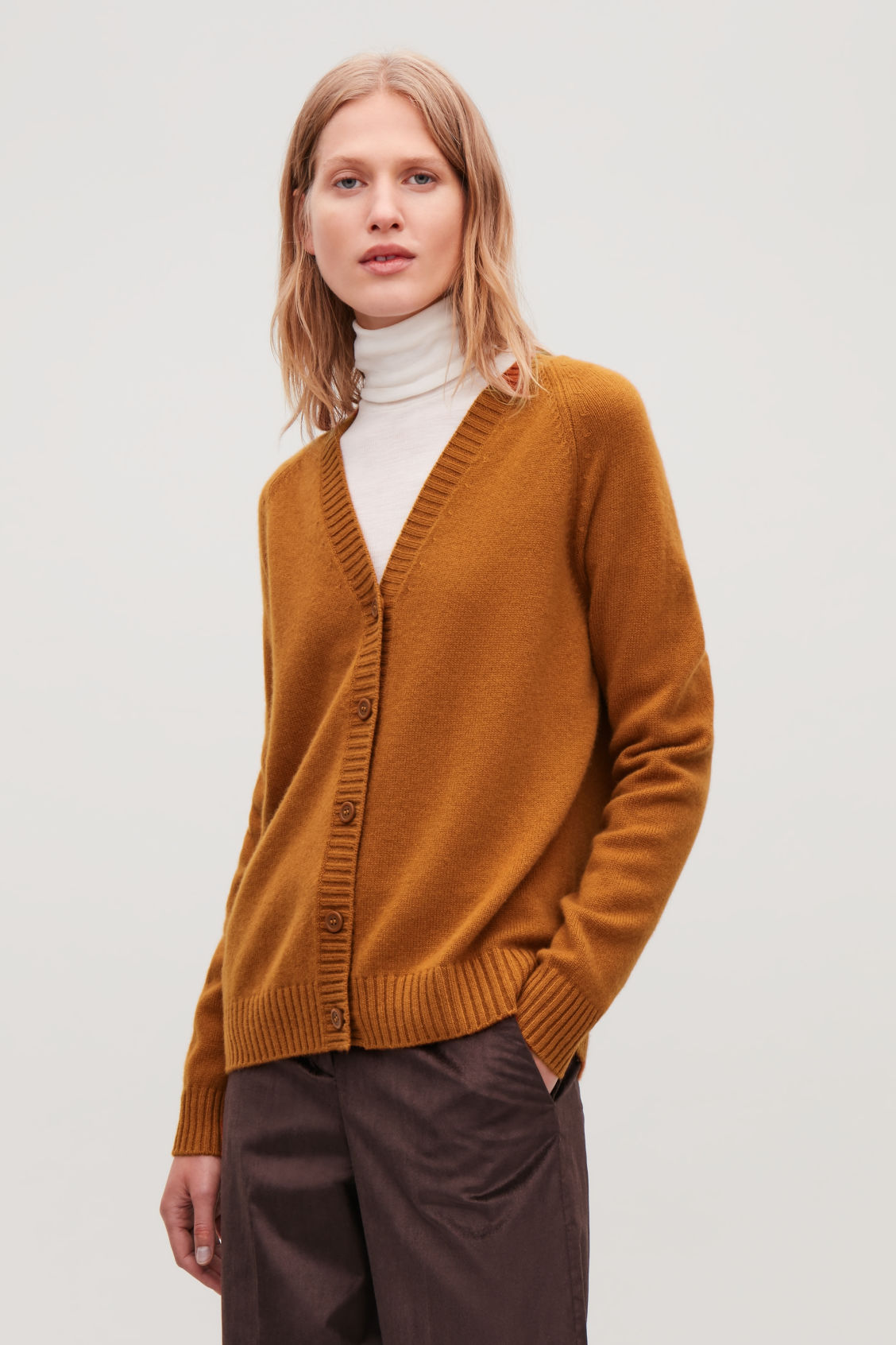 Model side image of Cos relaxed cashmere cardigan  in orange