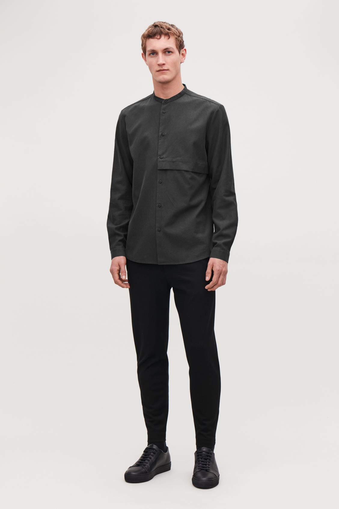 Model front image of Cos zip-cuff jersey trousers in black
