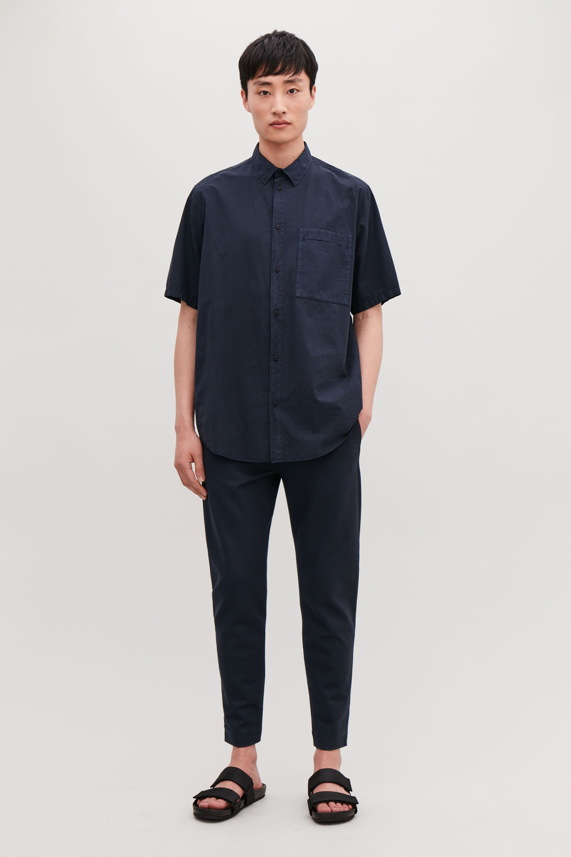 Model front image of Cos zip-cuff jersey trousers in blue