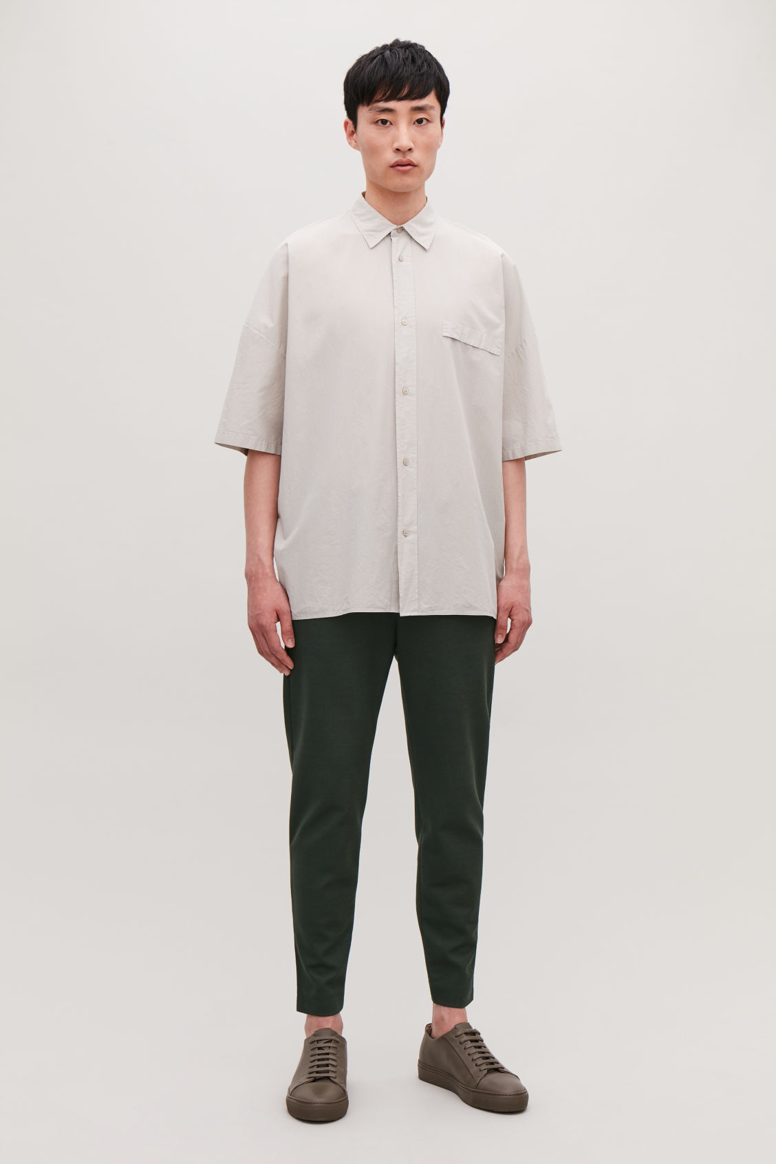 Model front image of Cos zip-cuff jersey trousers in green