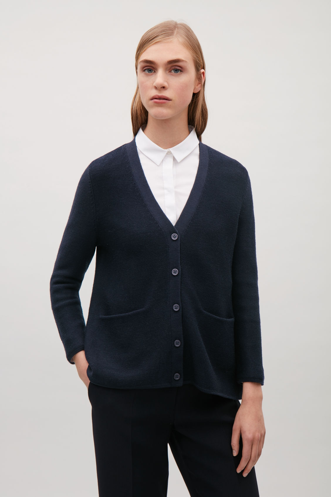 Model side image of Cos garter-stitch merino cardigan  in blue