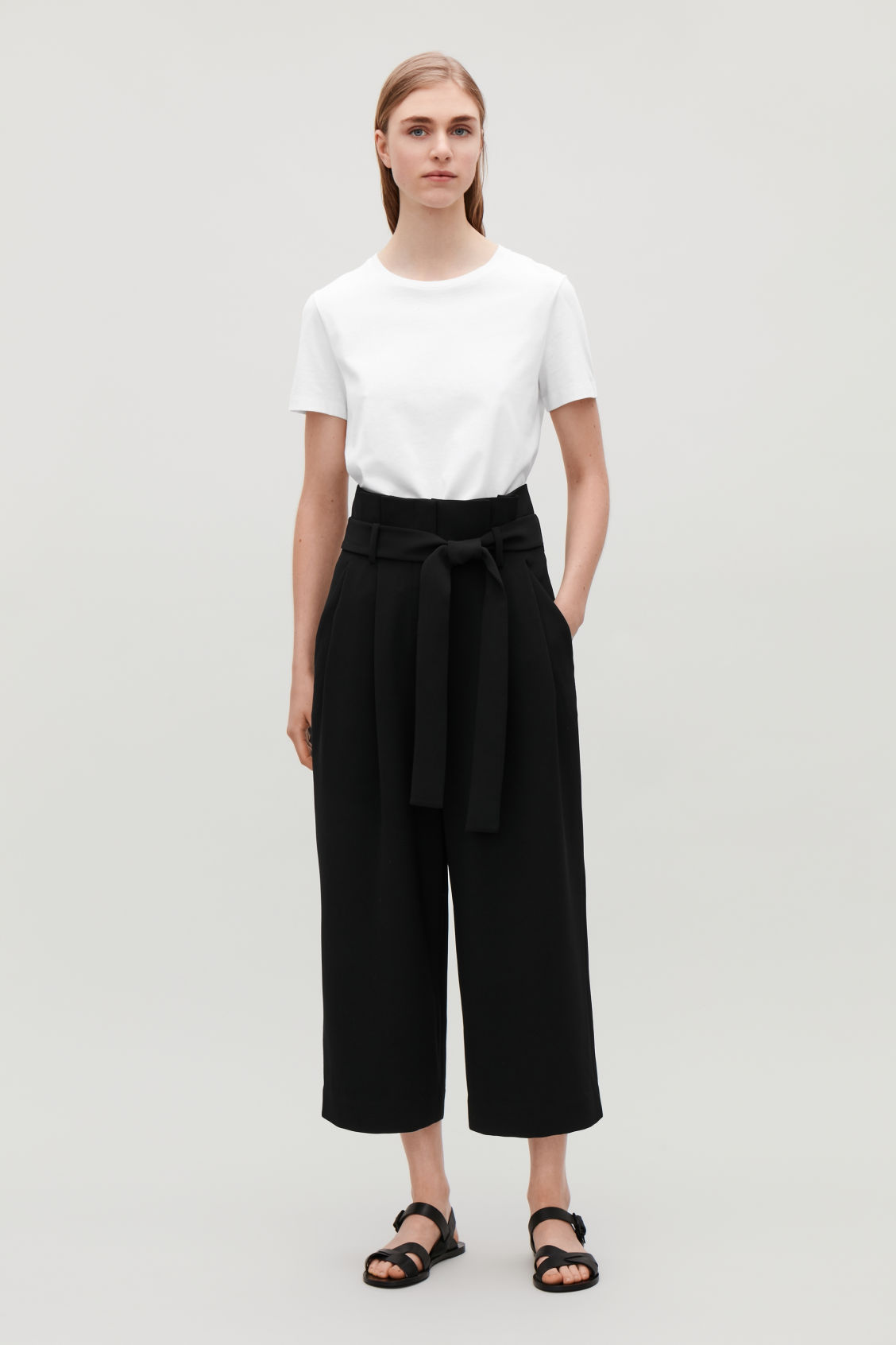 Model front image of Cos belted high-waist trousers in black