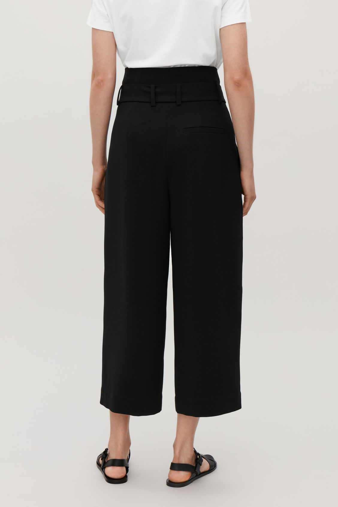 Model side image of Cos belted high-waist trousers in black