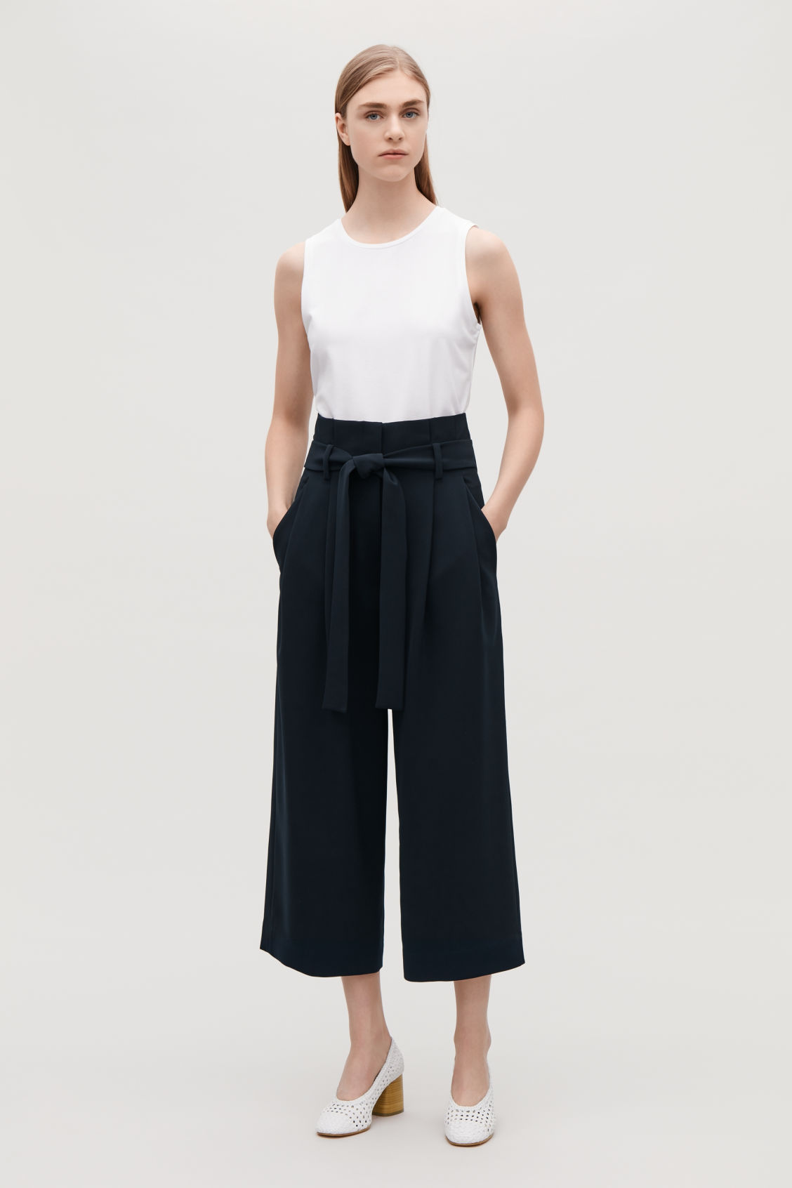 Model front image of Cos belted high-waist trousers in blue