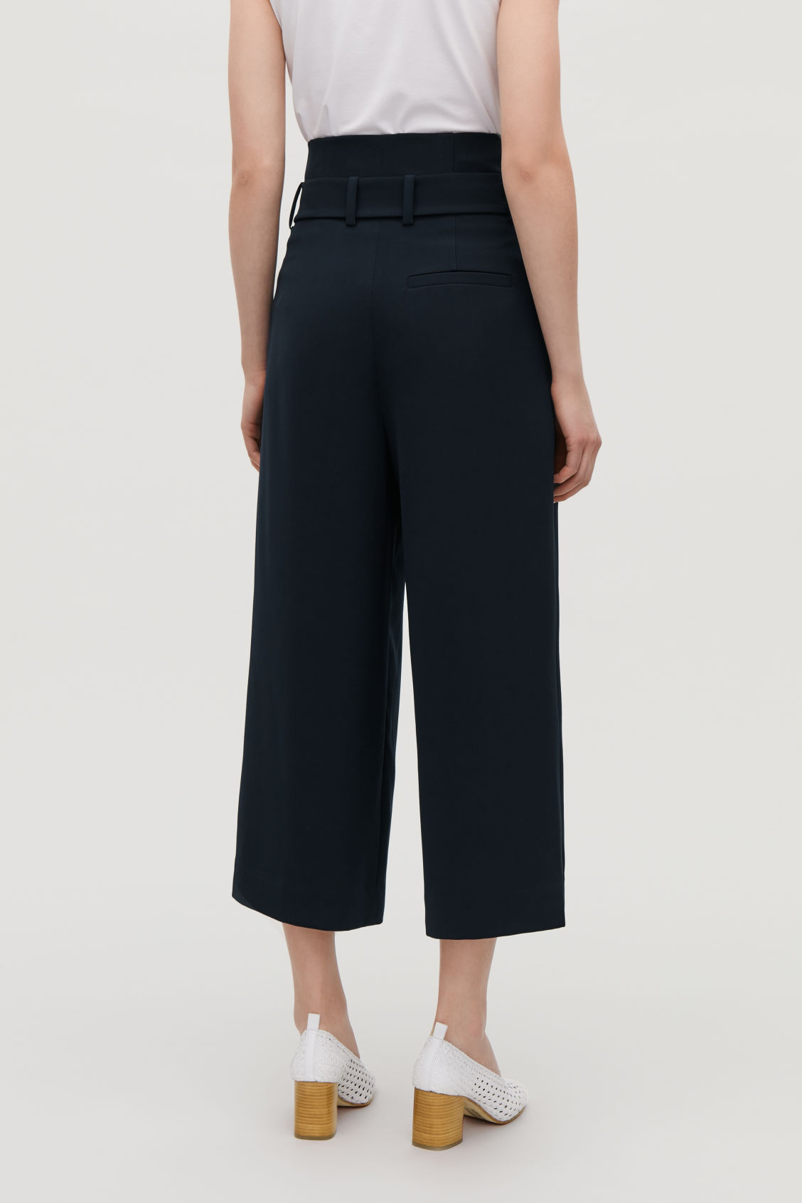 Model side image of Cos belted high-waist trousers in blue
