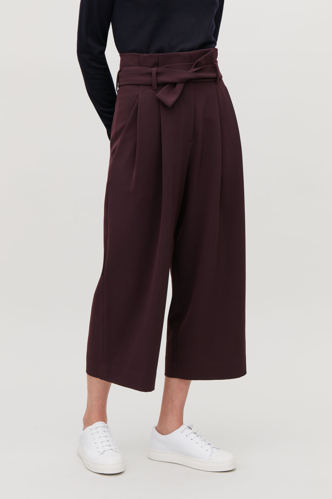 Model side image of Cos belted high-waist trousers in purple