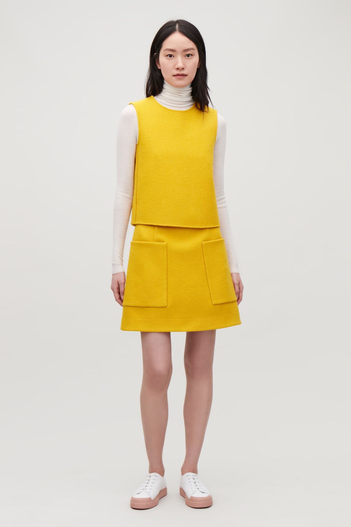 Model front image of Cos panelled wool vest top  in yellow