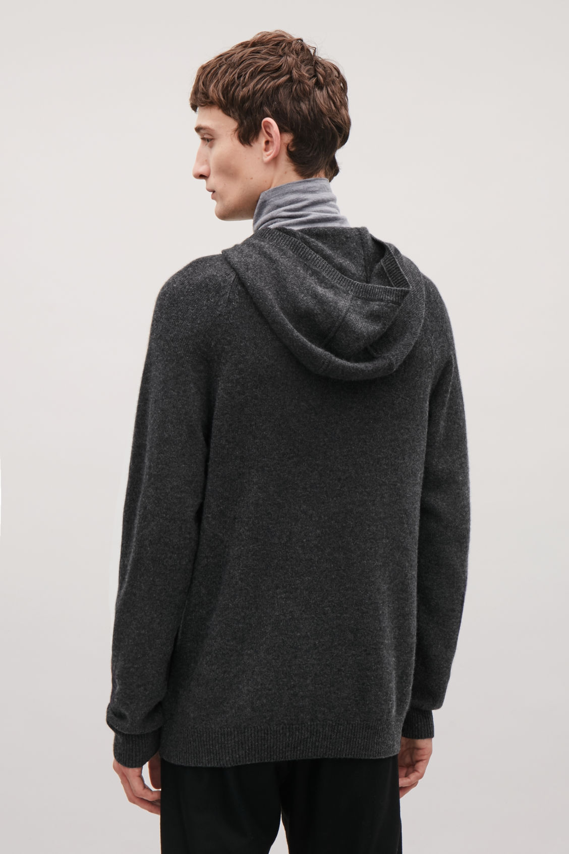 Model side image of Cos relaxed cashmere hoodie  in grey