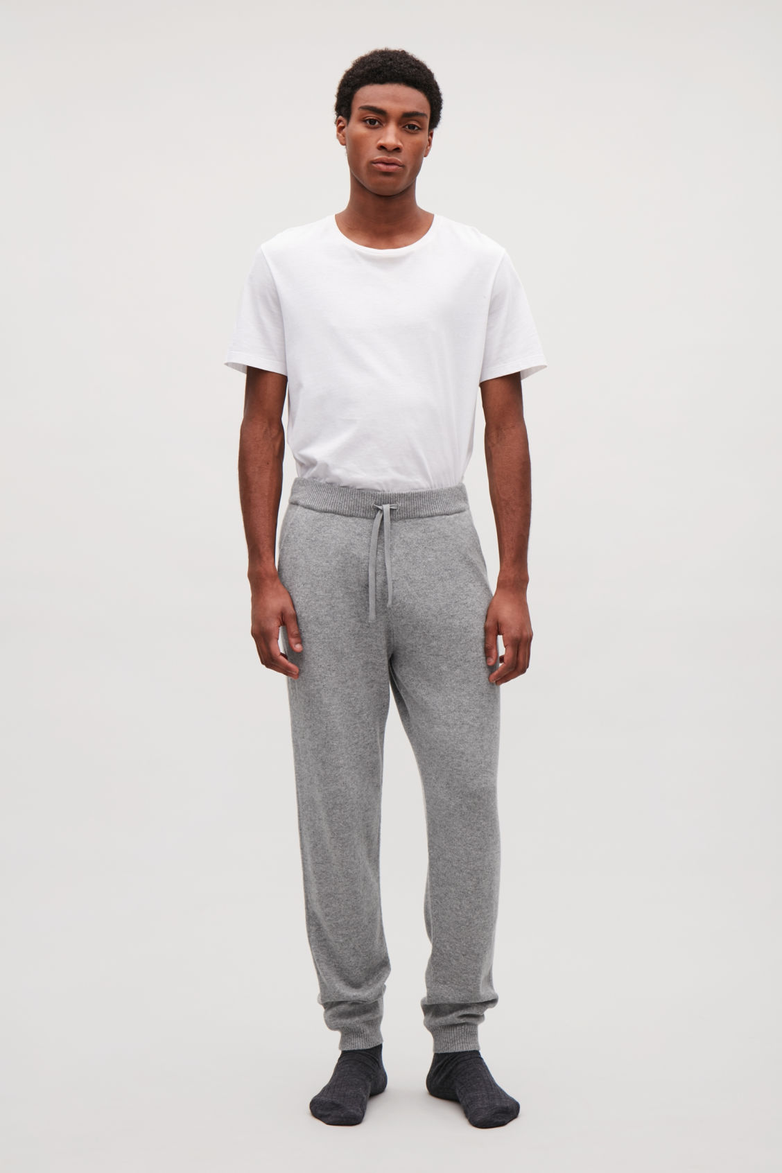 Model front image of Cos relaxed cashmere trousers  in grey