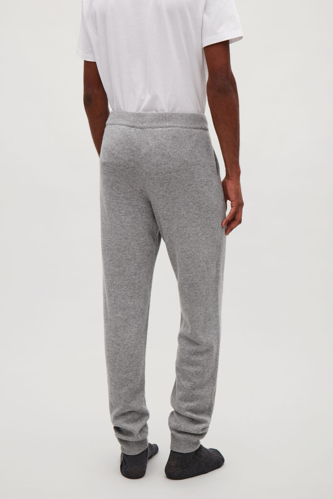 Model side image of Cos relaxed cashmere trousers  in grey