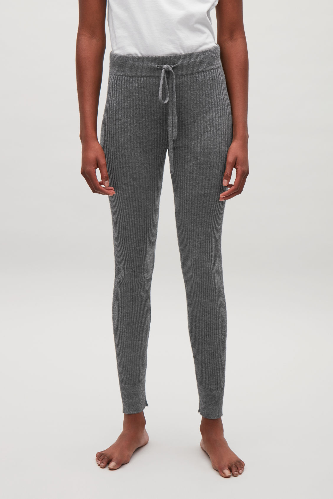 Model side image of Cos ribbed cashmere trousers  in grey