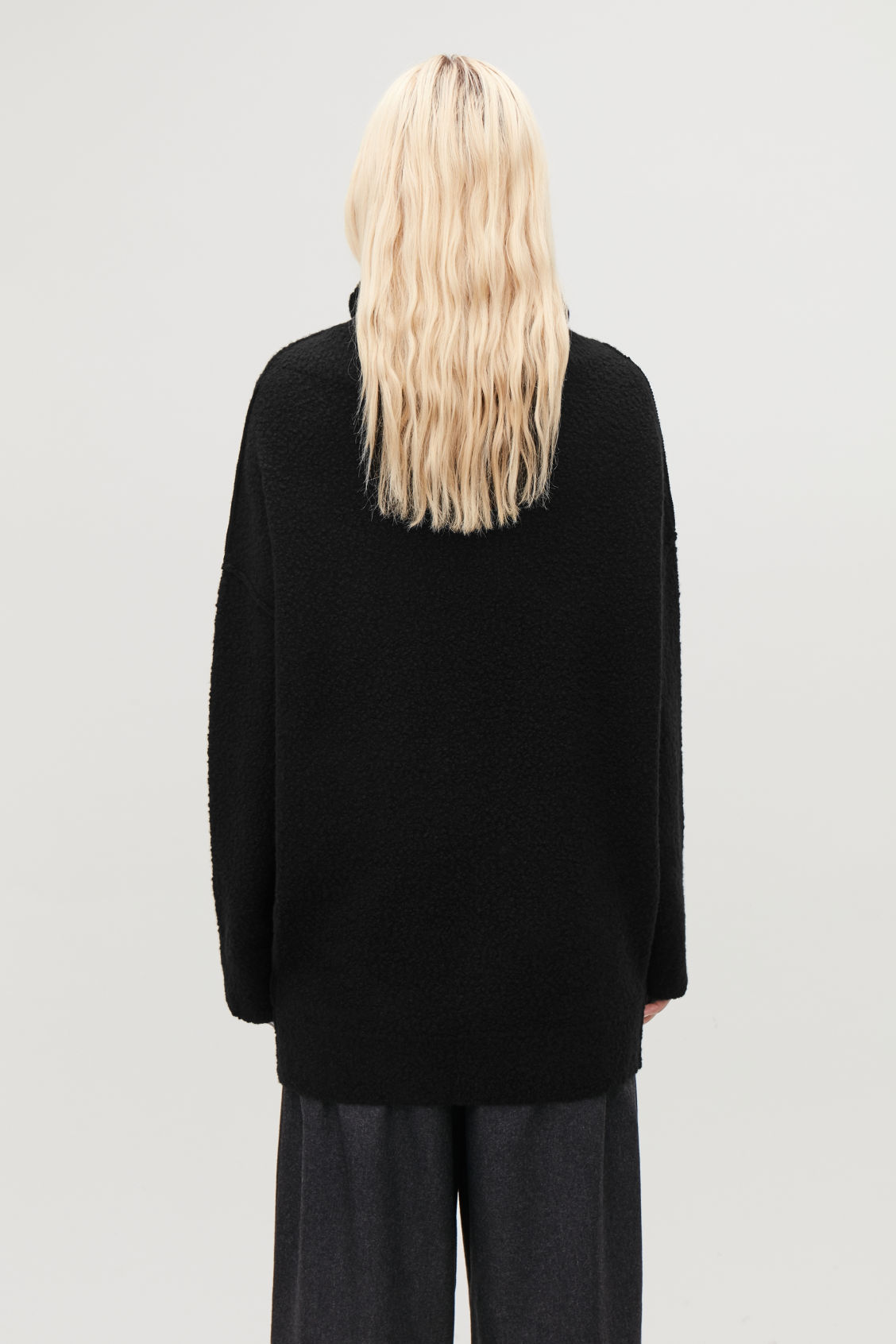 Model side image of Cos bobble-stitch oversized jumper  in black