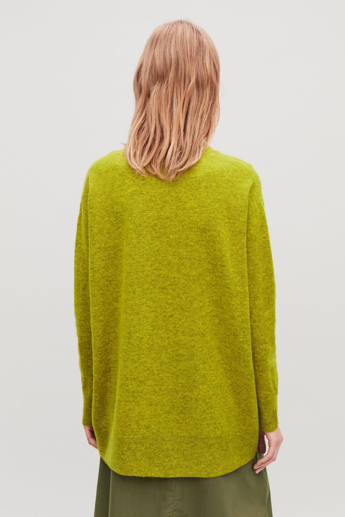 Model side image of Cos speckled oversized wool cardigan in yellow