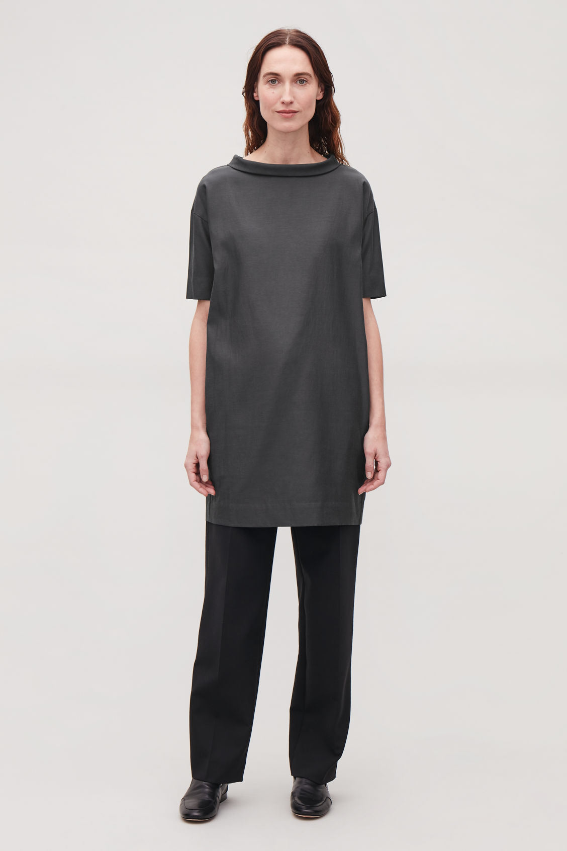 Model side image of Cos folded-collar draped dress in grey