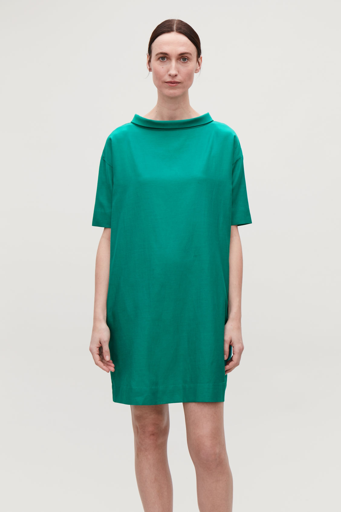 Model side image of Cos folded-collar draped dress in green