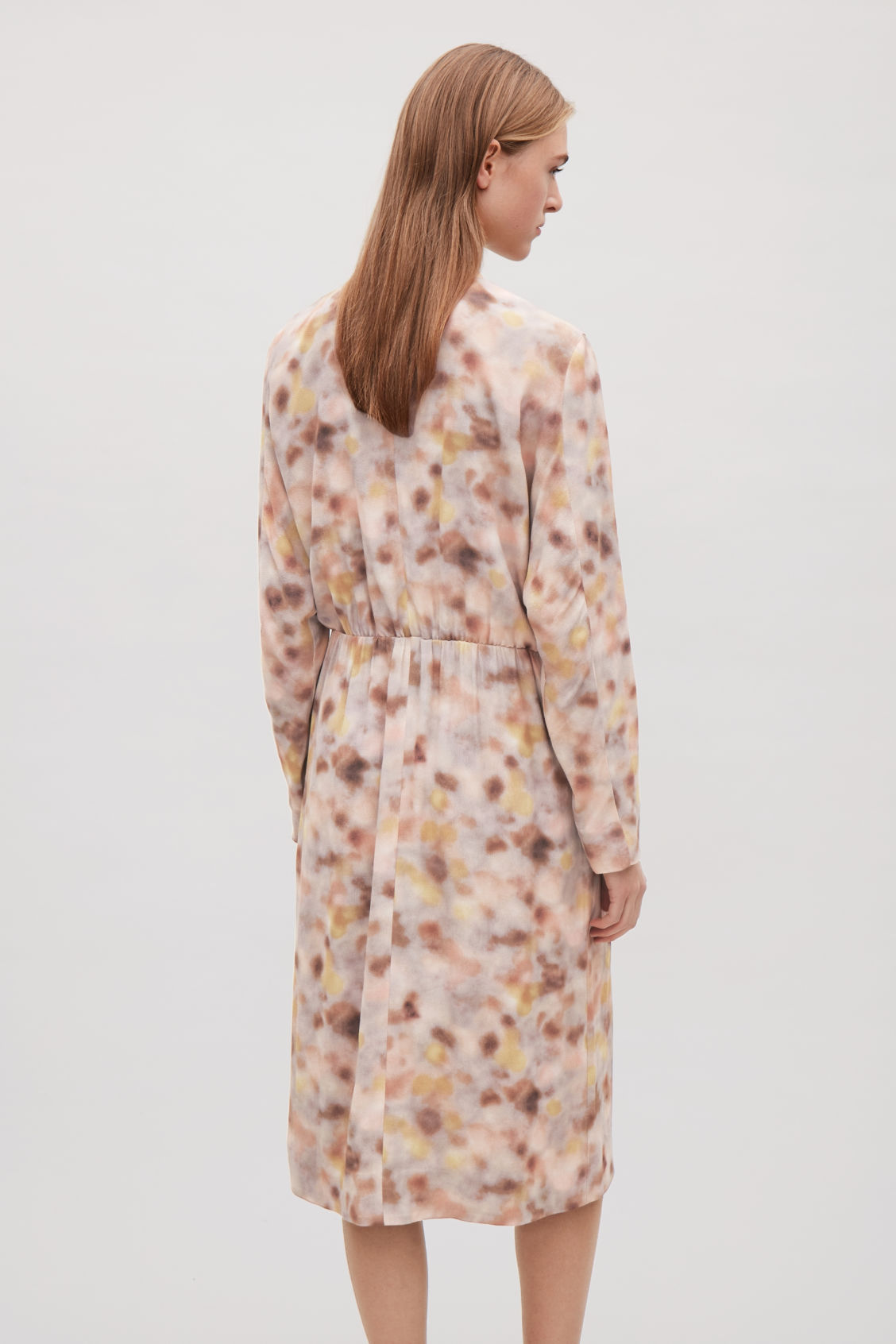 Model side image of Cos printed long-sleeve dress  in orange