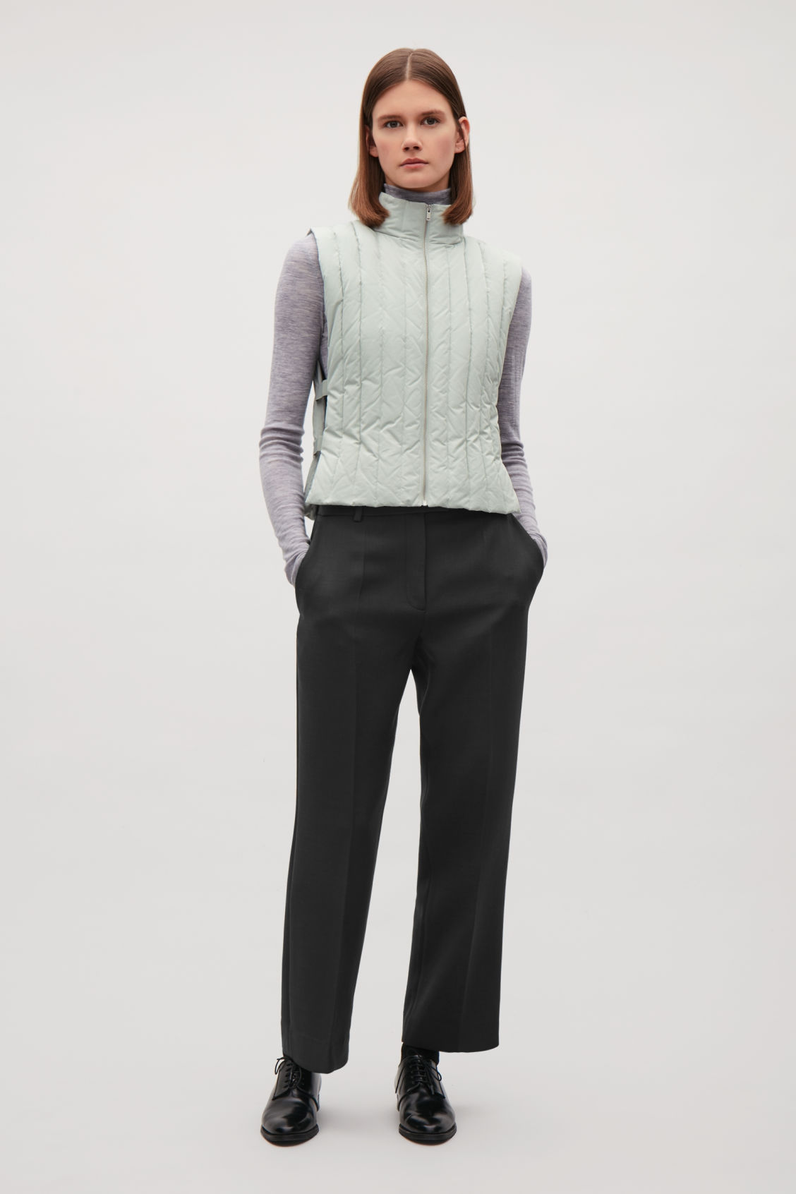 Model front image of Cos padded gilet with elastic detail in green