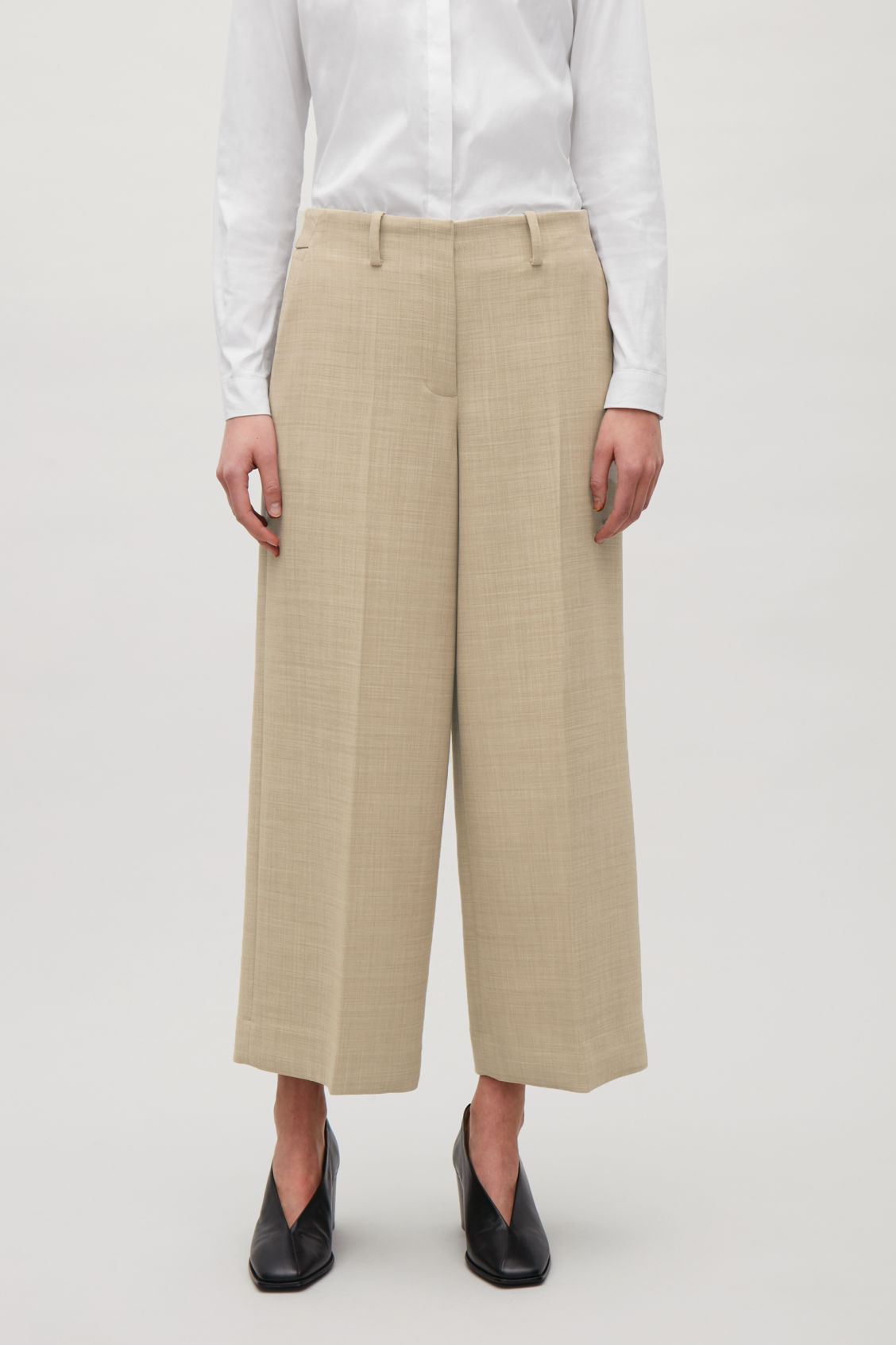 Model side image of Cos tailored wool culottes in beige
