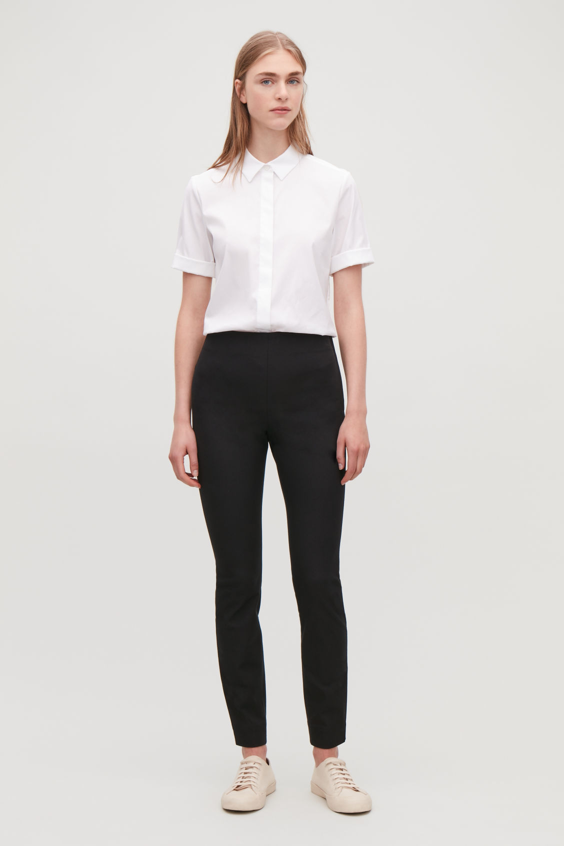 Model front image of Cos slim cotton twill trousers in black