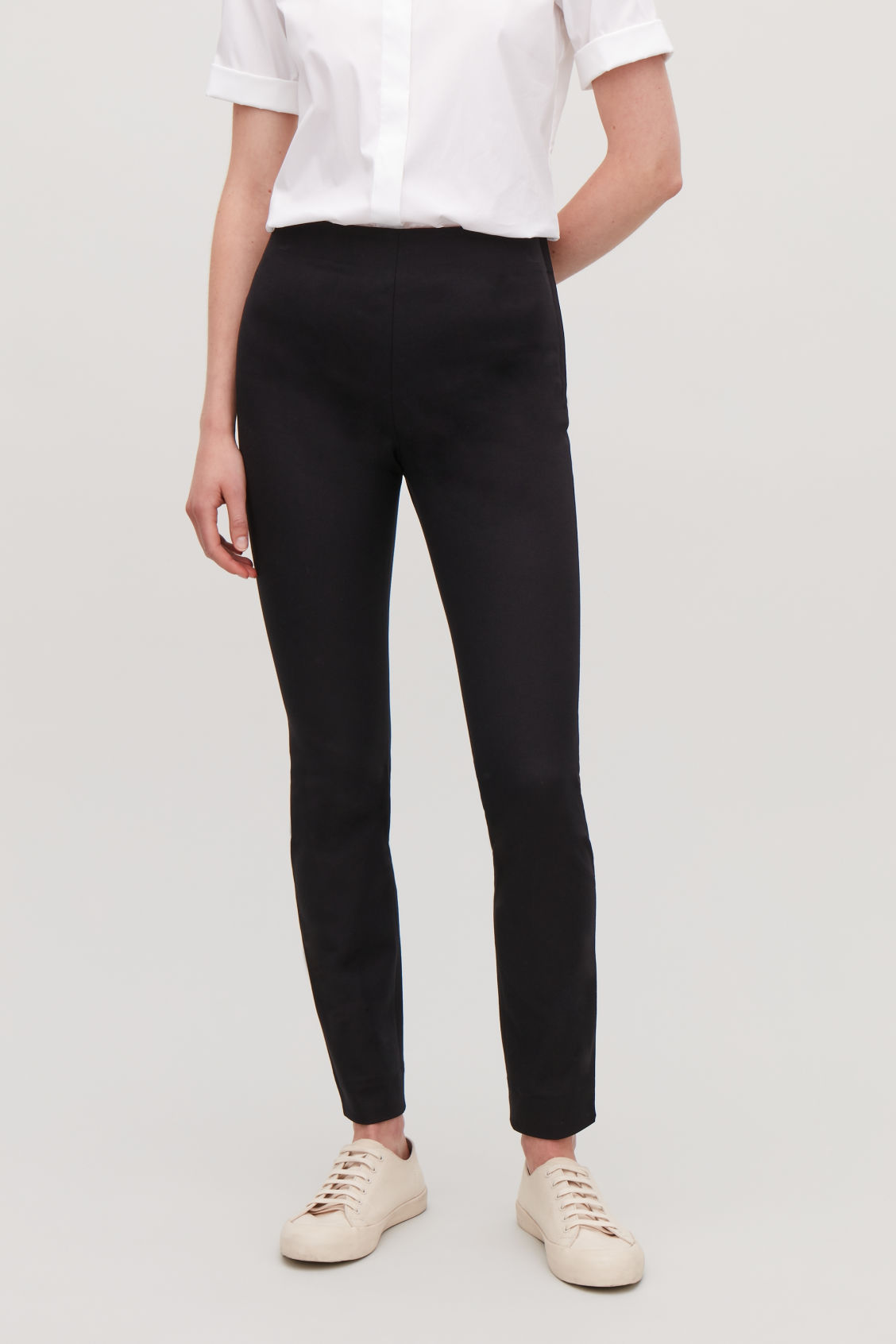 Model side image of Cos slim cotton twill trousers in black
