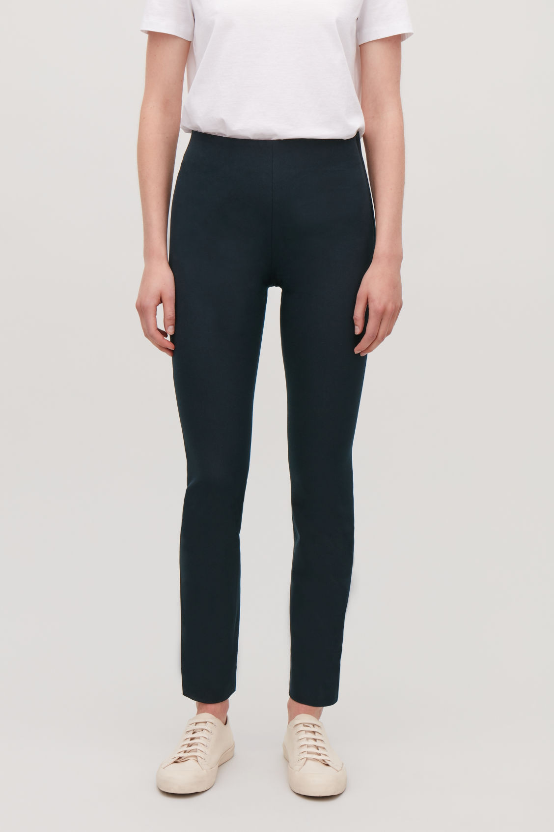 Model side image of Cos slim cotton-twill trousers in blue