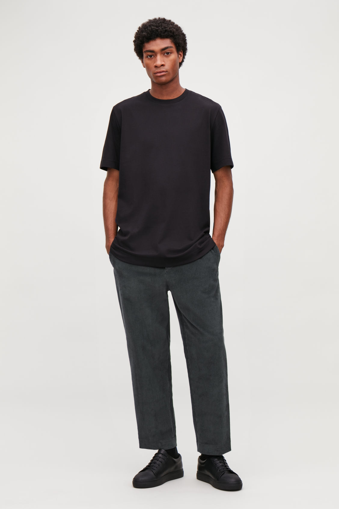 553bcf40fa58 Model front image of Cos tapered corduroy trousers in grey