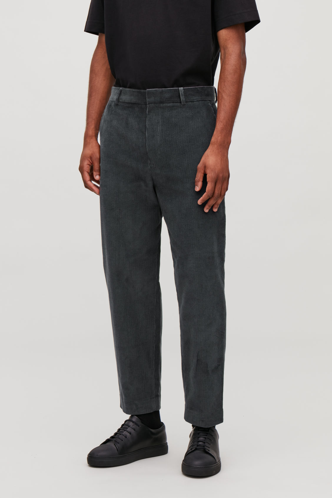 Model side image of Cos tapered corduroy trousers in grey