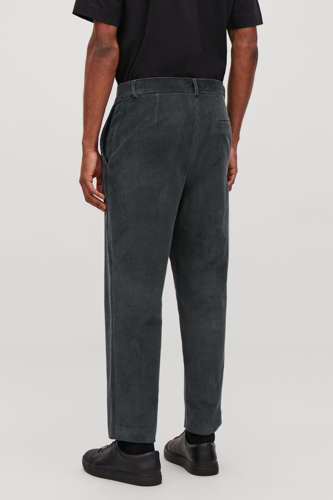 2426aa8976d5 Model side image of Cos tapered corduroy trousers in grey