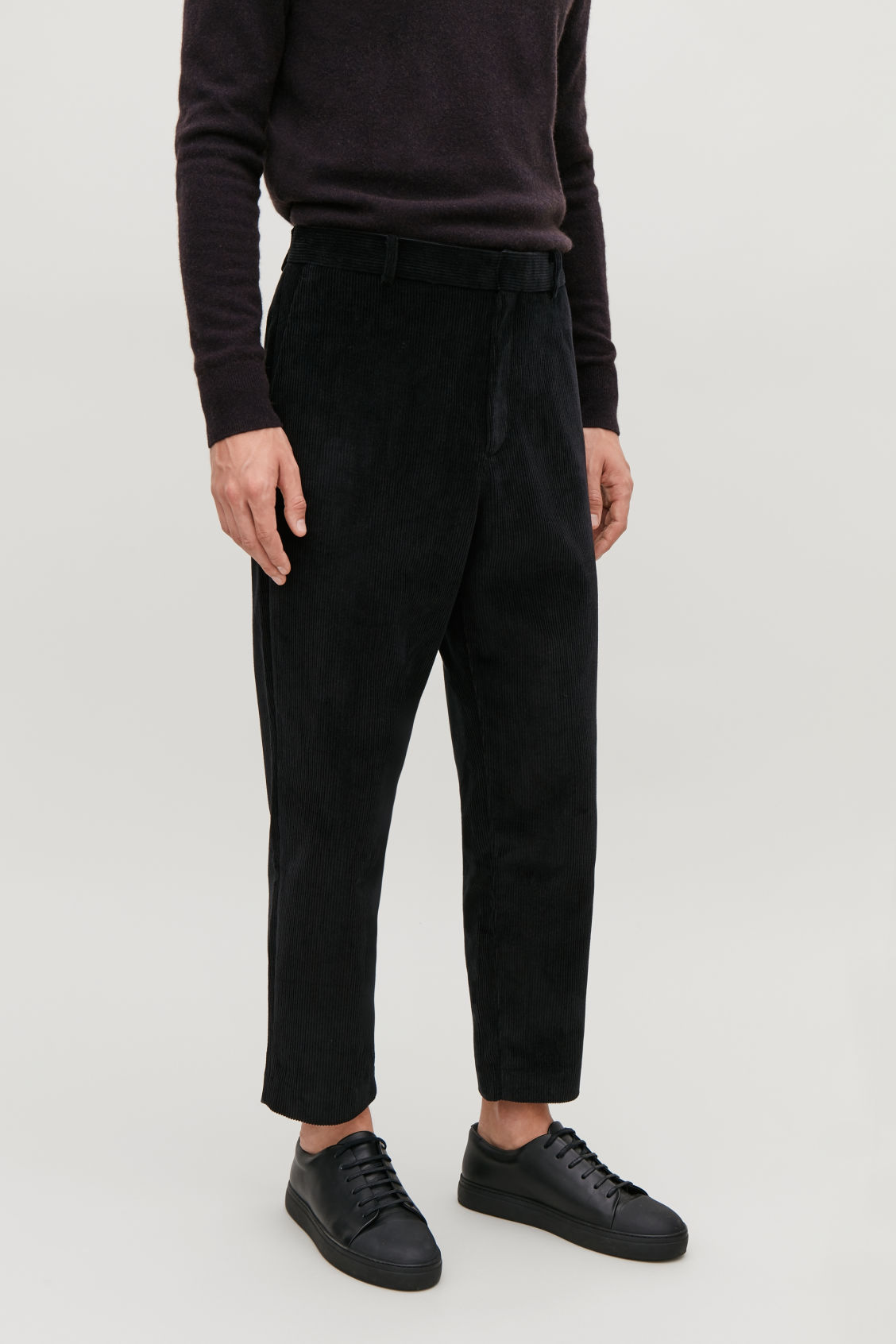 Model side image of Cos tapered corduroy trousers in black