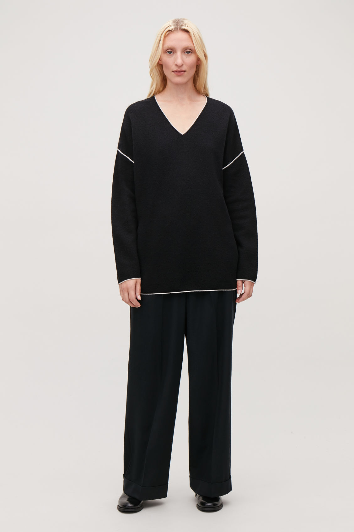Model front image of Cos merino jumper with contrast edge in black