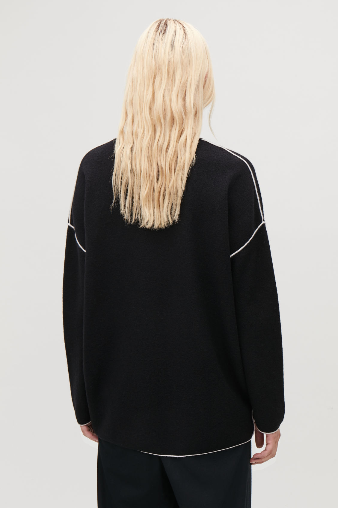 Model side image of Cos merino jumper with contrast edge in black