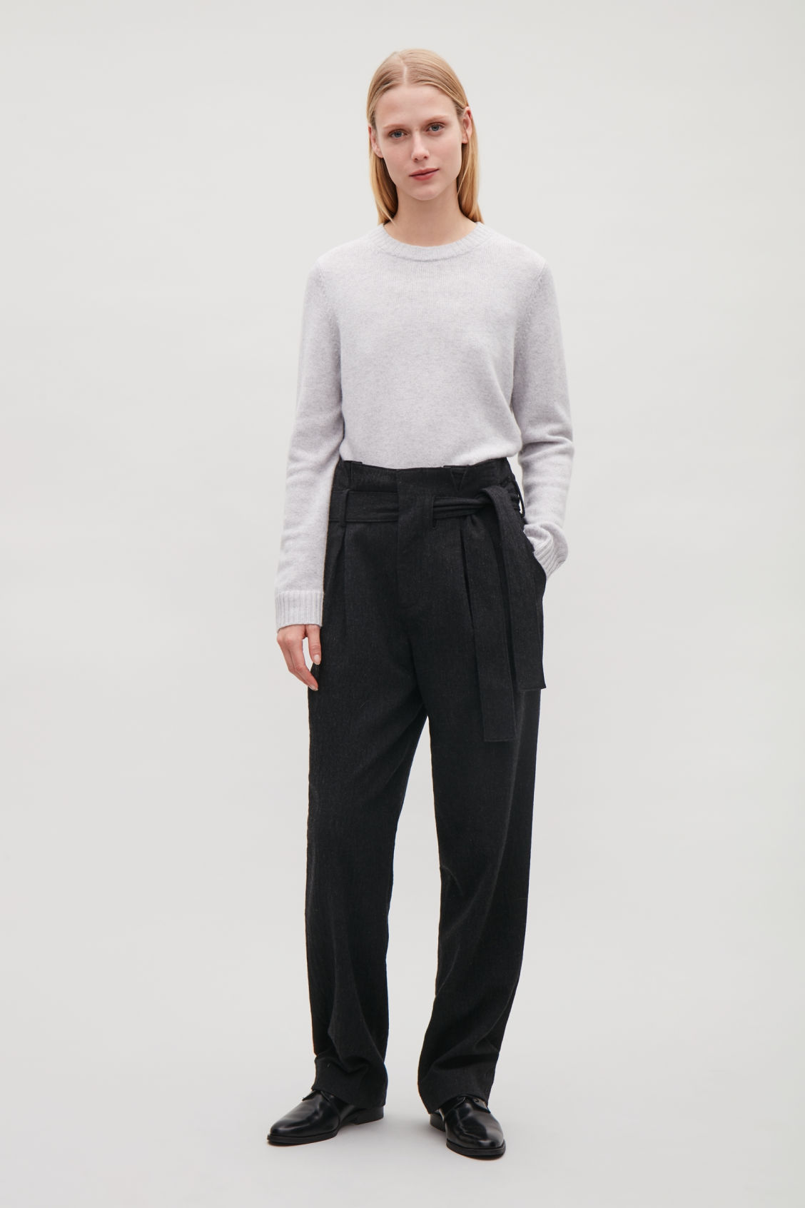 Model side image of Cos belted wool trousers  in grey