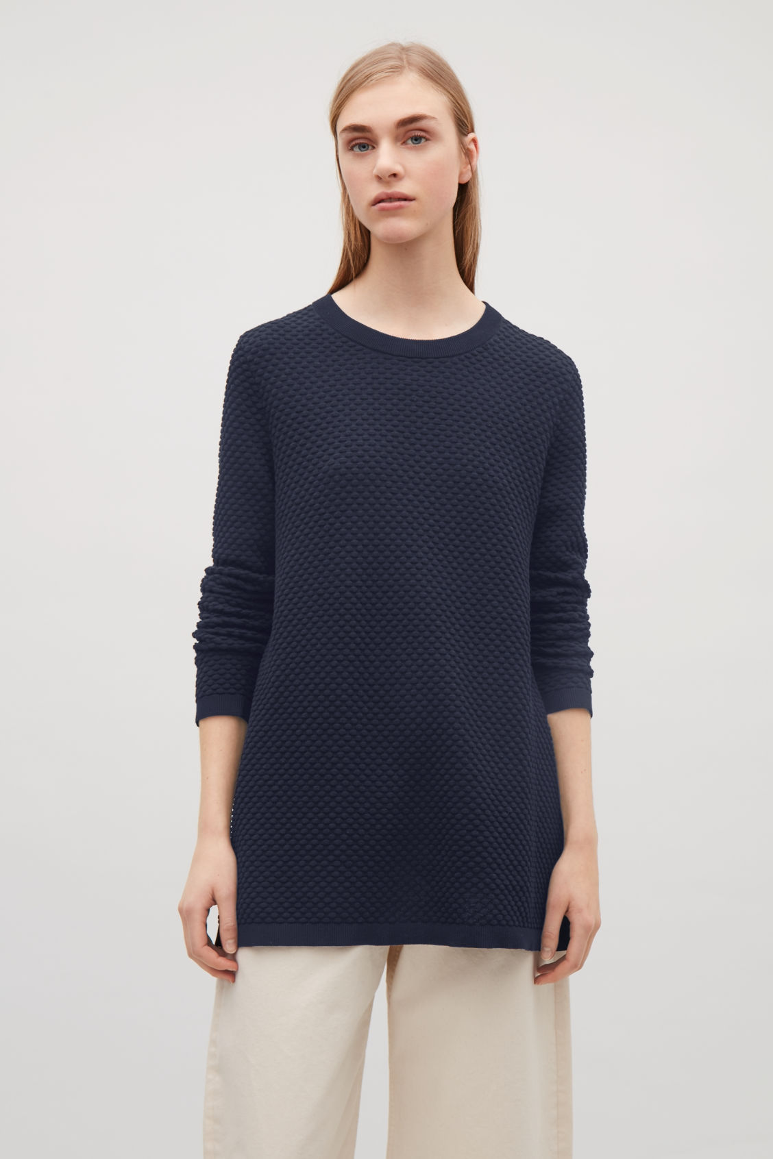 7bf6a231c937 Model side image of Cos textured cotton jumper in blue