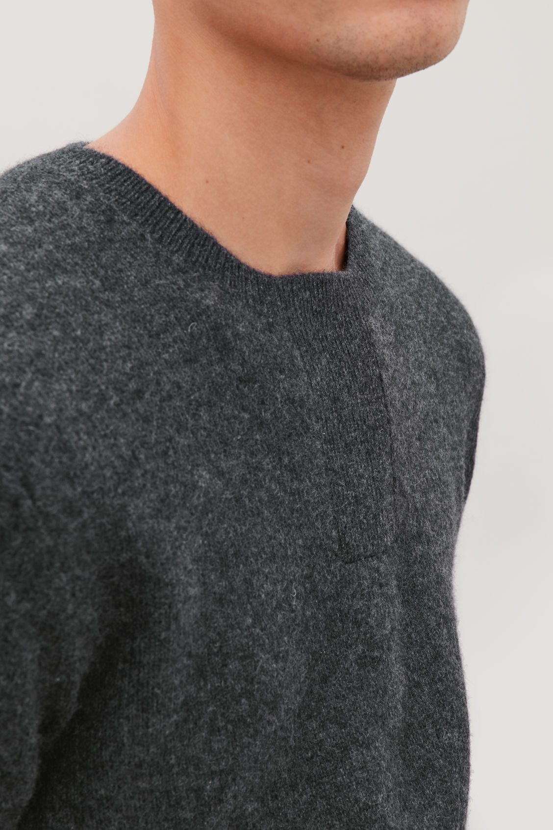 Model side image of Cos cashmere jumper with rectangle stitches in grey