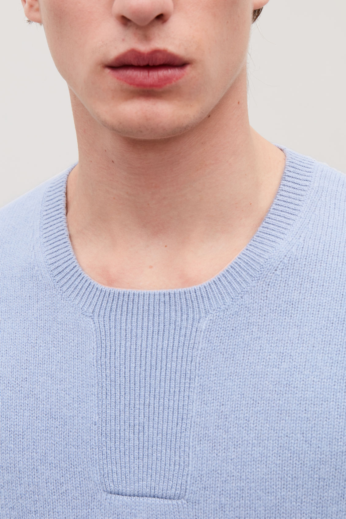 Model side image of Cos stitch-detailed cashmere jumper in blue