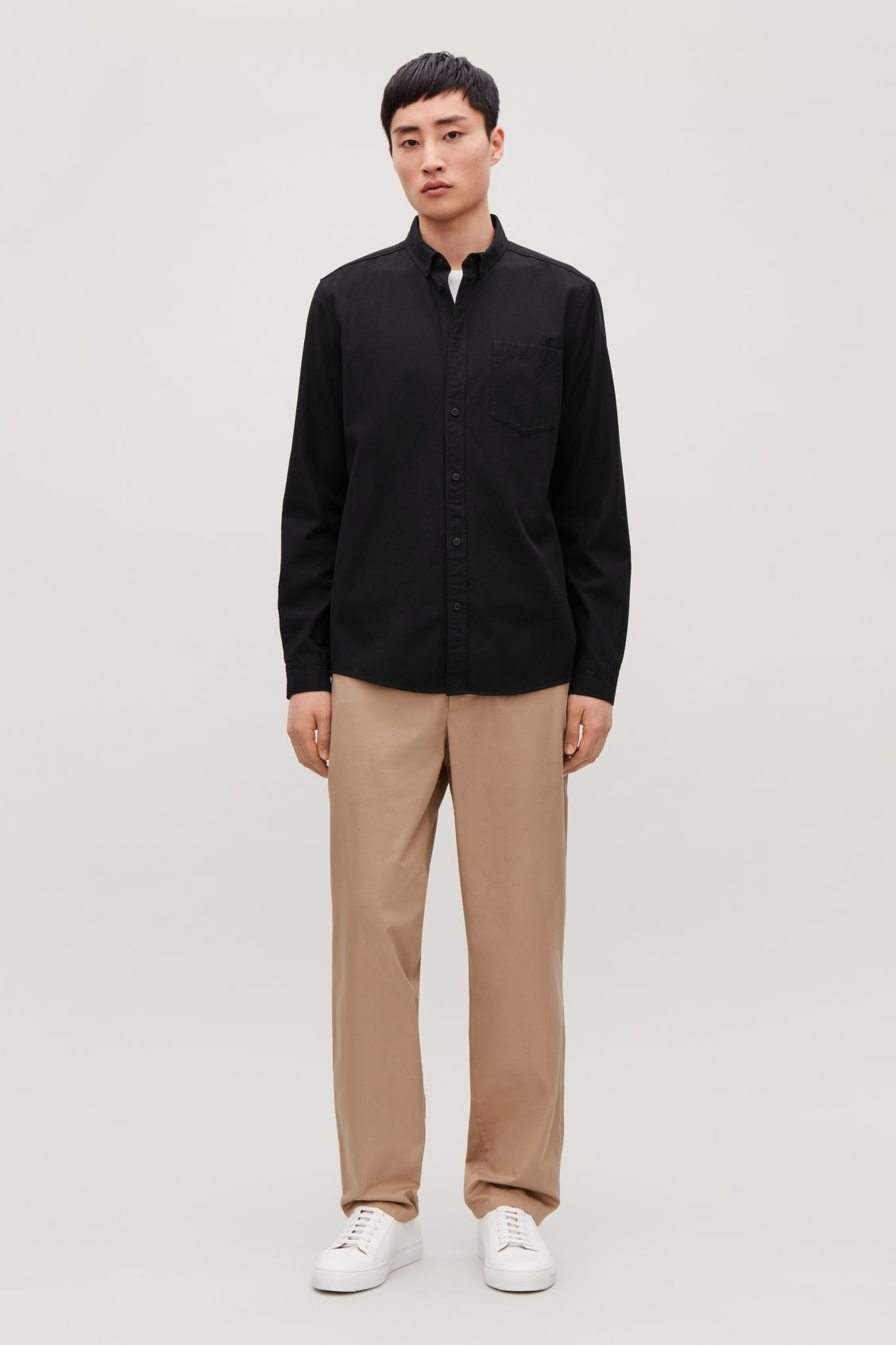 Model front image of Cos cotton button-down shirt  in black