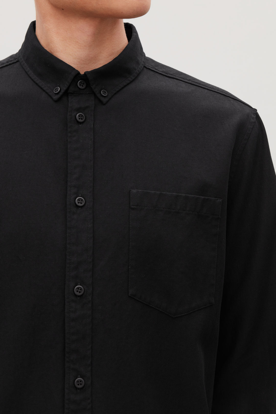 Model side image of Cos cotton button-down shirt  in black
