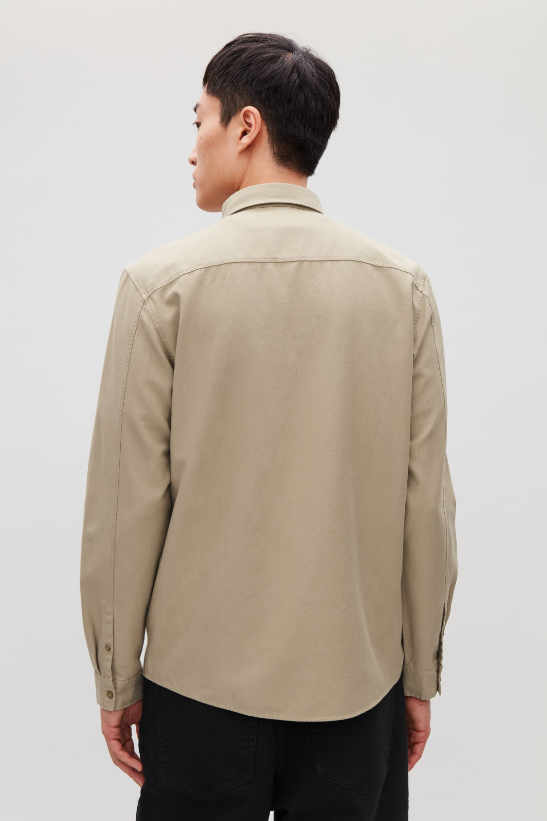 Model side image of Cos cotton button-down shirt  in beige