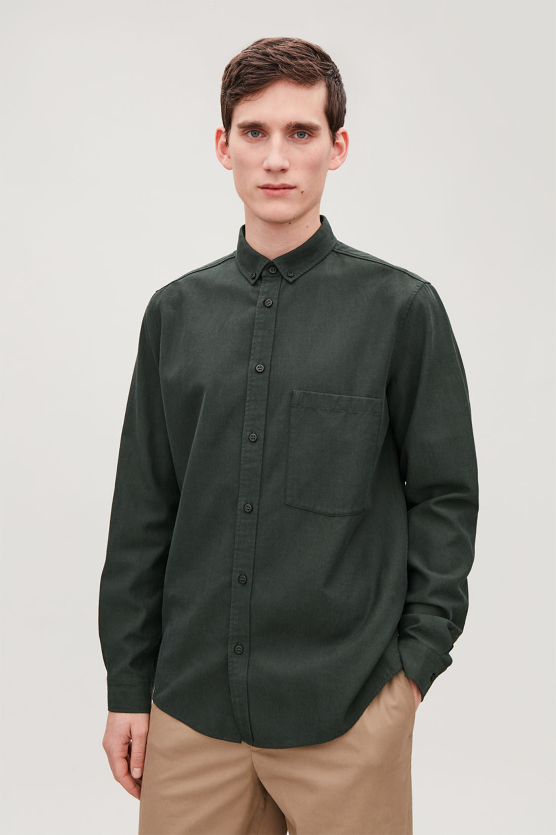 Model side image of Cos cotton button-down shirt  in green