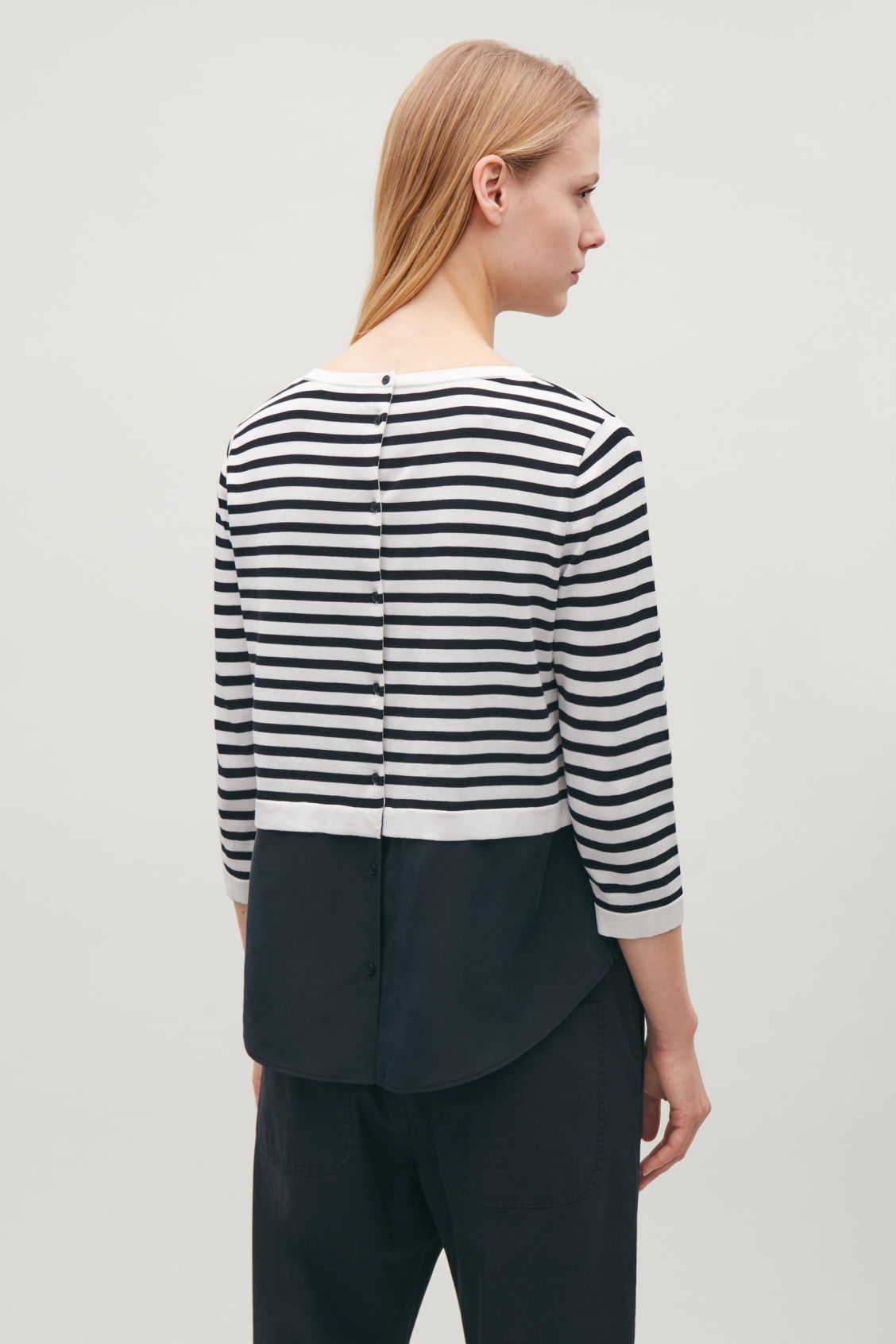 Model side image of Cos silk-panelled knit top in blue