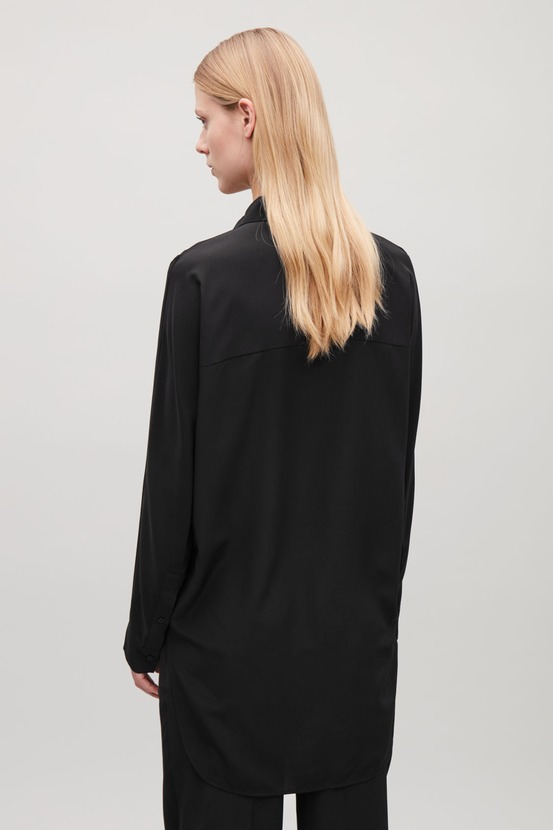 Model side image of Cos cocoon silk shirt  in black