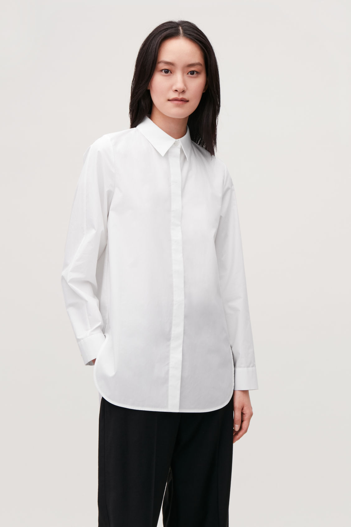 Model side image of Cos cocoon cotton-poplin shirt  in white