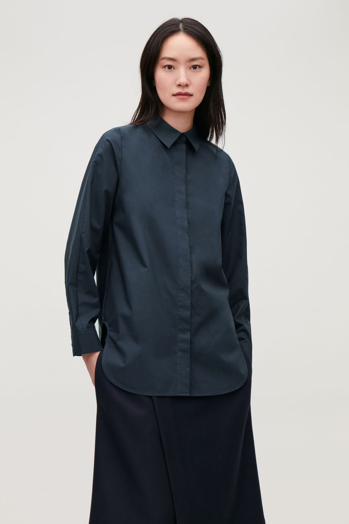 Model side image of Cos cocoon cotton-poplin shirt  in blue