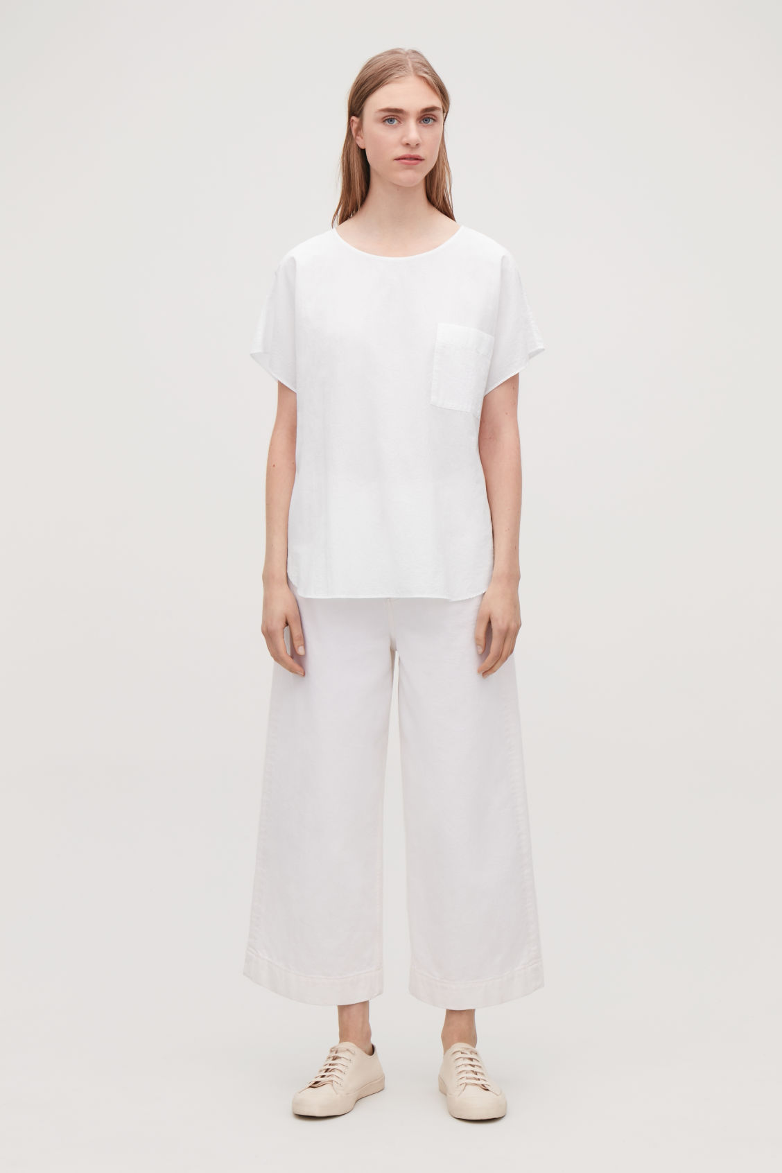 Model front image of Cos oversized cotton top in white