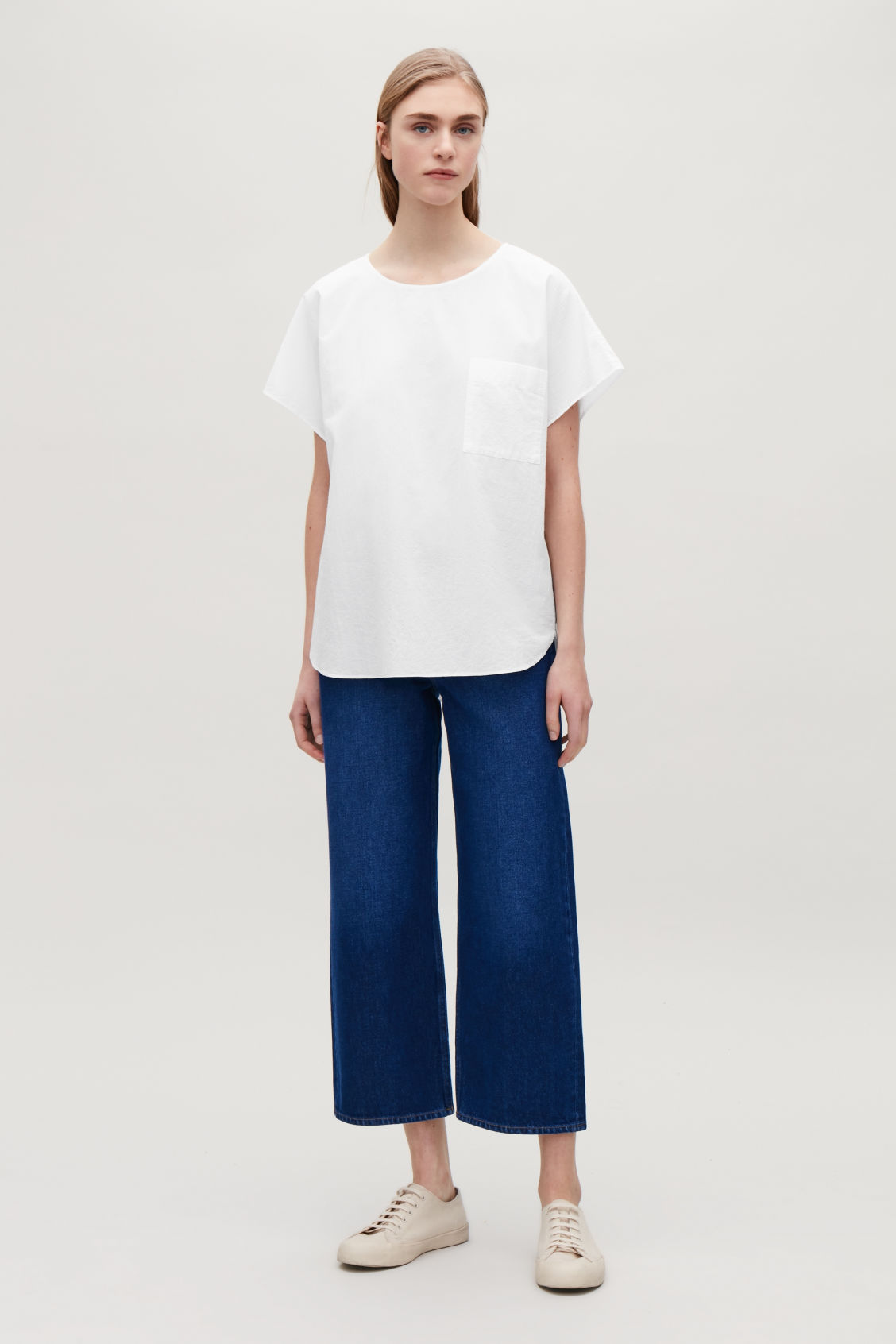 Model side image of Cos oversized cotton top in white