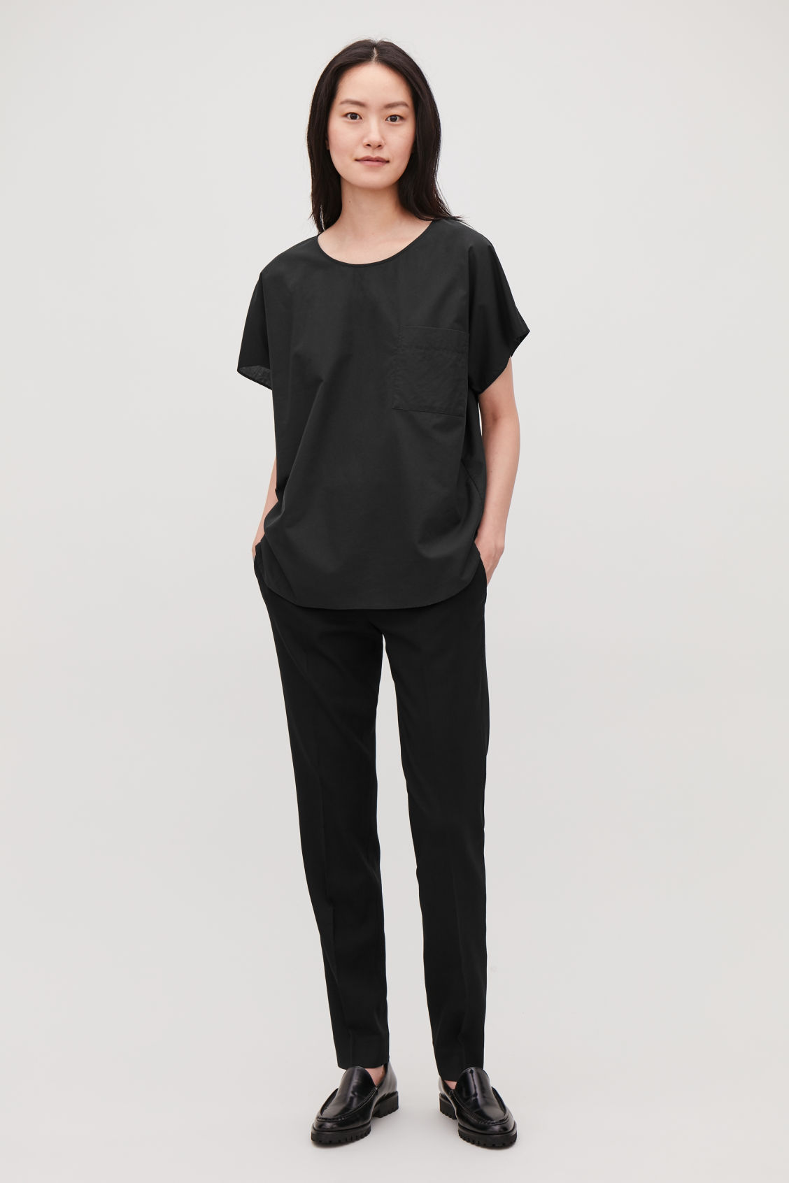 Model front image of Cos oversized cotton top in black