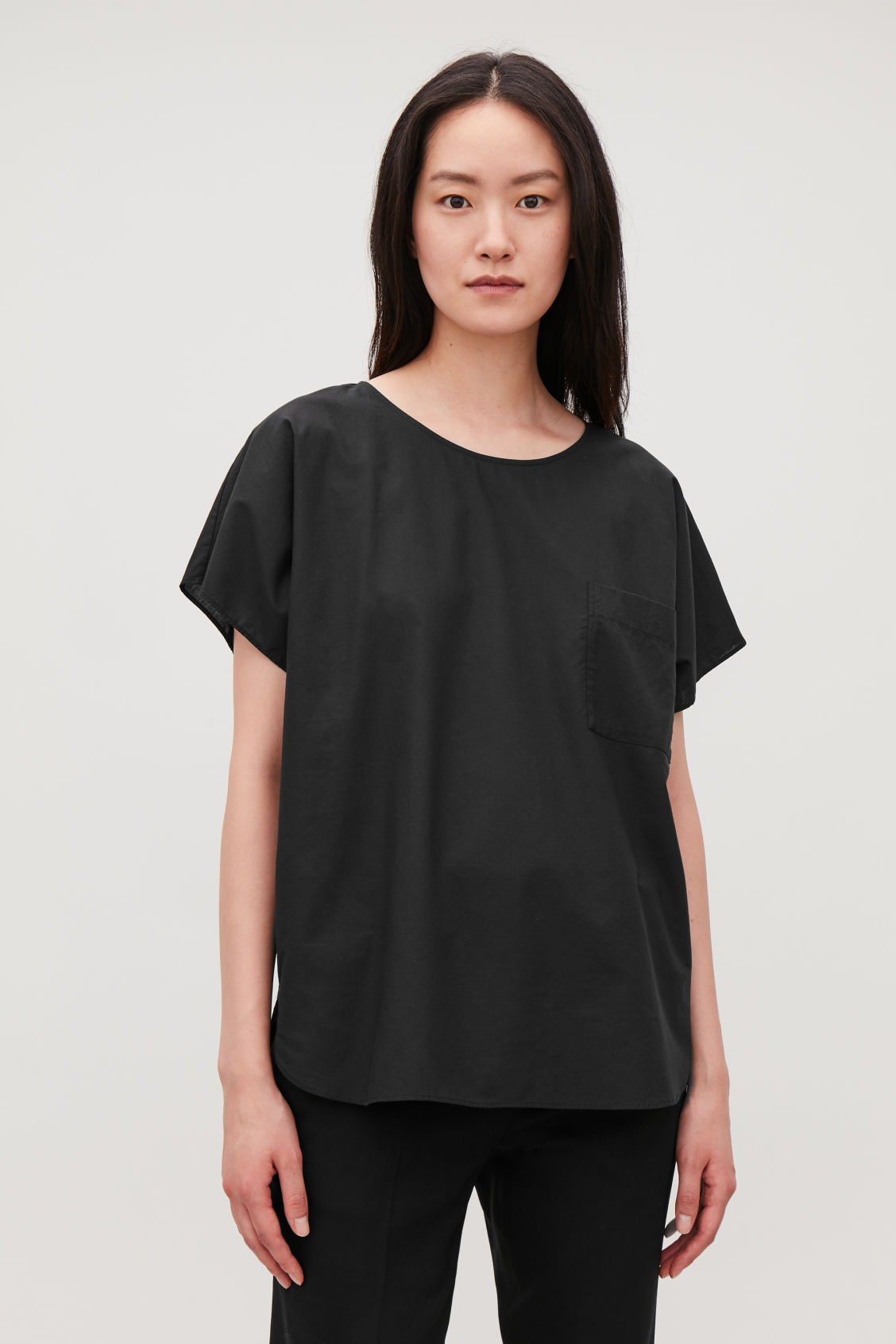 Model side image of Cos oversized cotton top in black